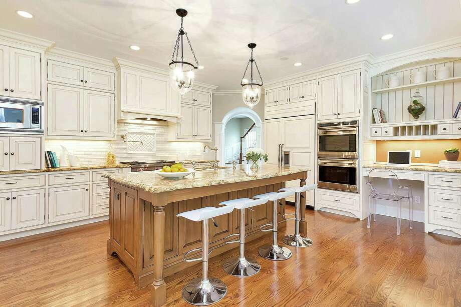 The kitchen opens into a breakfast room. Photo: Contributed / Contributed Photo / New Canaan News