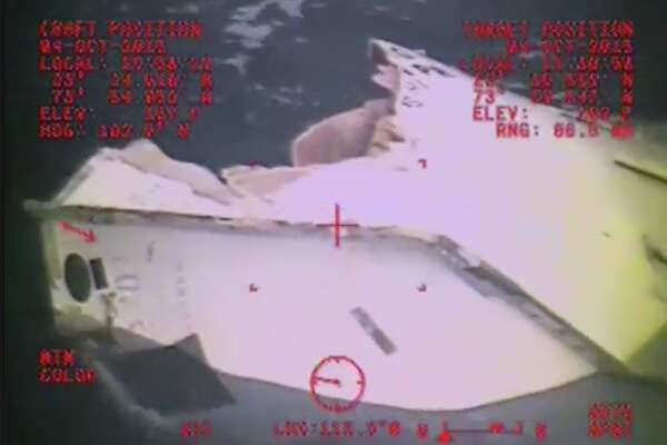 A Coast Guard Air Station Miami MH-60 Jayhawk helicopter crew investigates a life boat Sunday, Oct. 4, 2015, that was found from the missing ship El Faro. El Faro lost propulsion and communications prior to Hurricane Joaquin passing directly over it.