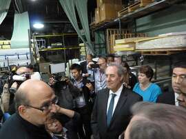 "(FILES) In this October 1, 2015 file photo, US Trade Representative Michael Froman(C) takes a break from negotiations on the Trans-Pacific Partnership trade treaty in Atlanta, Georgia to visit the Colgate Mattress Factory. Twelve Pacific rim countries sealed the deal October 5, 2015 on creating the world's largest free trade area, delivering President Barack Obama a major policy triumph. The deal on the Trans-Pacific Partnership, led by the United States and Japan, aims to set the rules for 21st century trade and investment and press China, not one of the 12, to shape its behavior in commerce to the TPP standards. ""After five years of intensive negotiations, we have come to an agreement that will create jobs, drive sustainable growth, foster inclusive development, and promote innovation across the Asia Pacific Region,"" said US Trade Representative Michael Froman.   AFP PHOTO/PAUL HANDLEY / FILESPAUL HANDLEY/AFP/Getty Images"