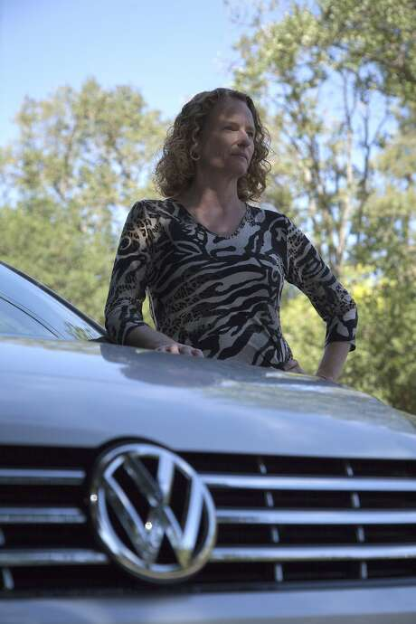 Breese Berkowitz, pictured with her 2015 Volkswagen Passat TDI, Sunday, Oct. 4, 2015, in Walnut Creek, Calif. Berkowitz bought the vehicle just six days before regulators announced that VW had monkeyed with its cars to pass emissions tests. Photo: Santiago Mejia, Special To The Chronicle