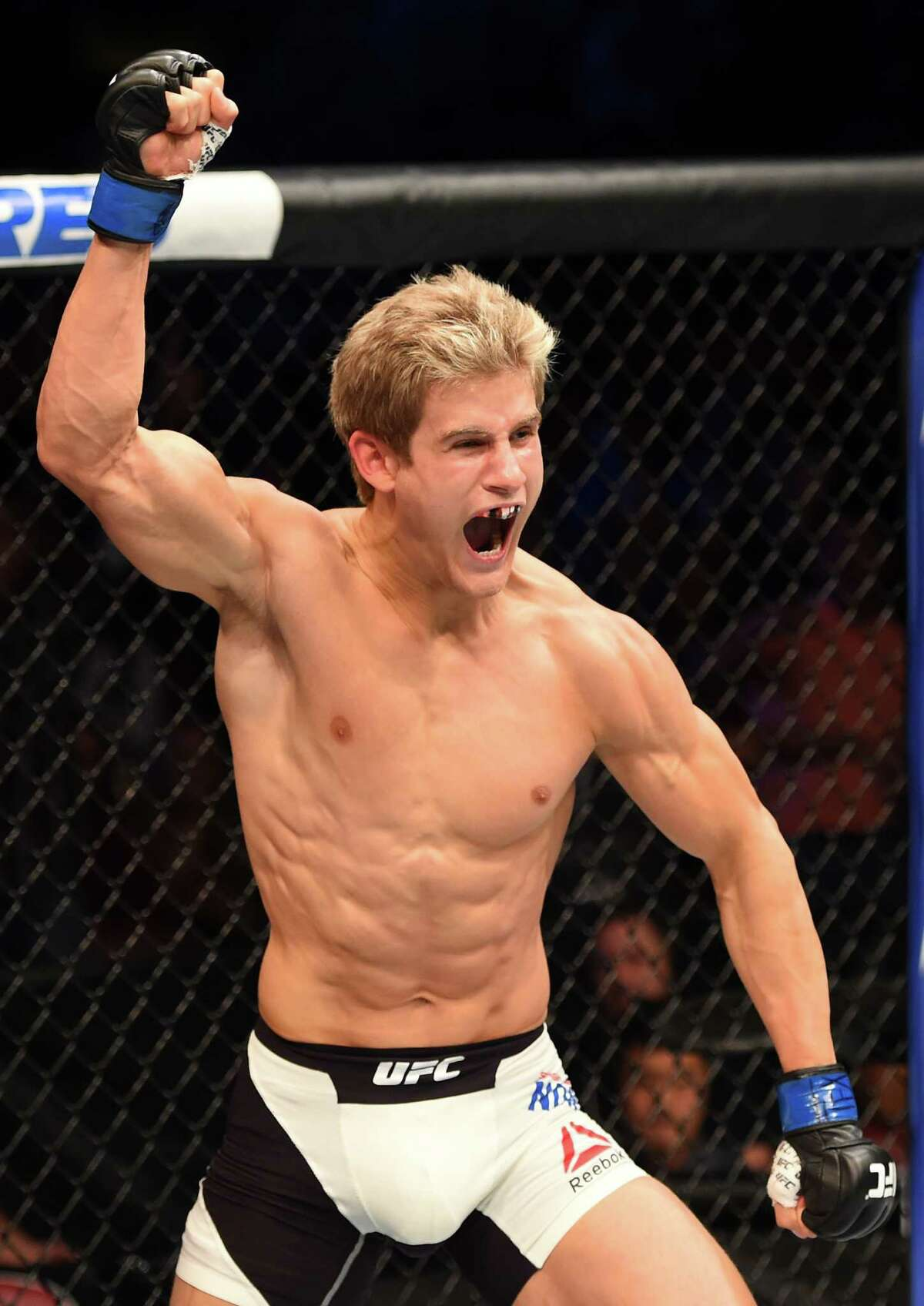 HOUSTON, TX - OCTOBER 03: in their lightweight bout during the UFC 192 event at the Toyota Center on October 3, 2015 in Houston, Texas.