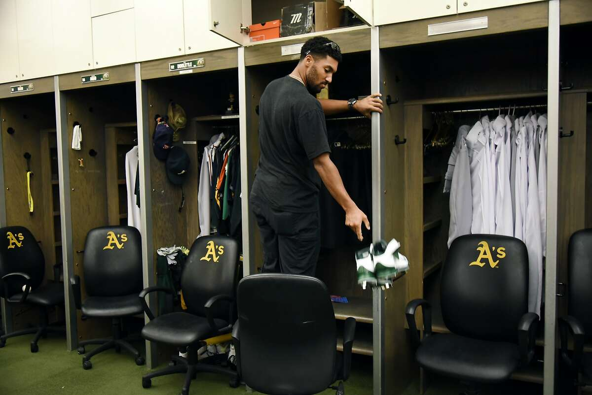 Athletic's short stop Marcus Semien #10 clears out his locker following the end of the 2015 baseball season, at O.co Coliseum in Oakland, CA Monday, October 5, 2015.