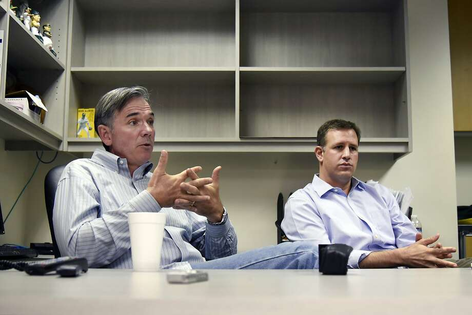 Newly appointed Vice President of Baseball Operations Billy Beane, left, and newly appointed General Manager David Forst, speak to the media during a press conference at O.co Coliseum in Oakland, Calif. Monday, October 5, 2015. Photo: Michael Short, Special To The Chronicle