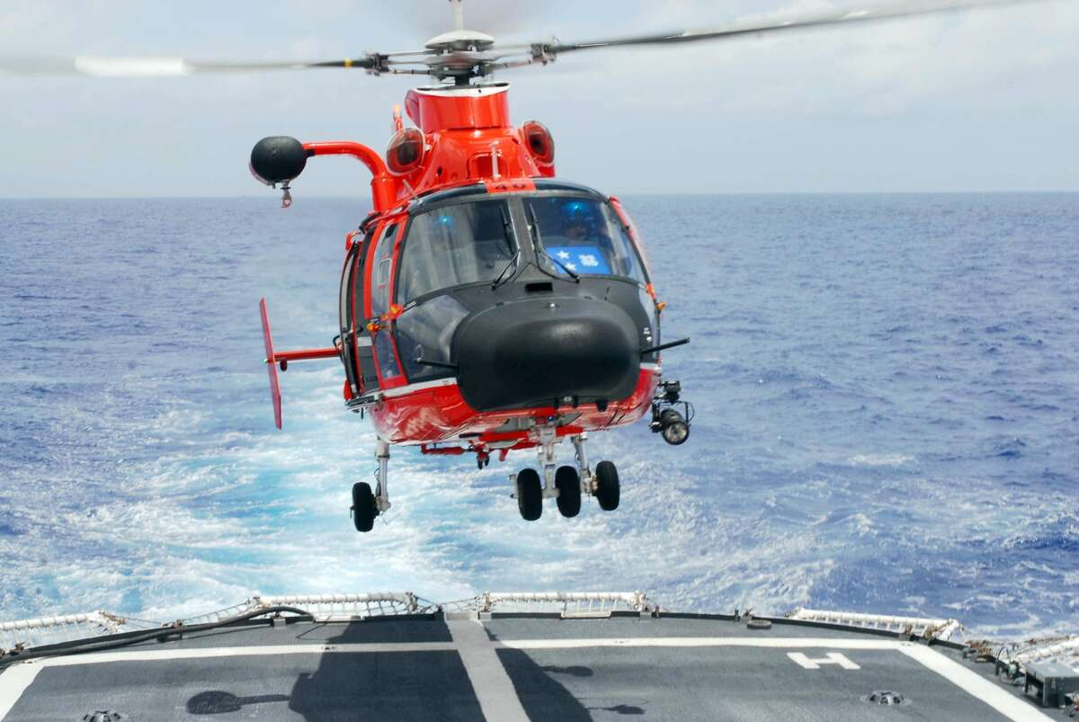 A Coast Guard HH-65C Dolphin helicopter lands on the Coast Guard Cutter Resolute while work continues at the Deepwater Horizon spill site as part of the largest oil spill response in history, July 4, 2010. U.S. Coast Guard photo by Petty Officer 1st Class John Masson.