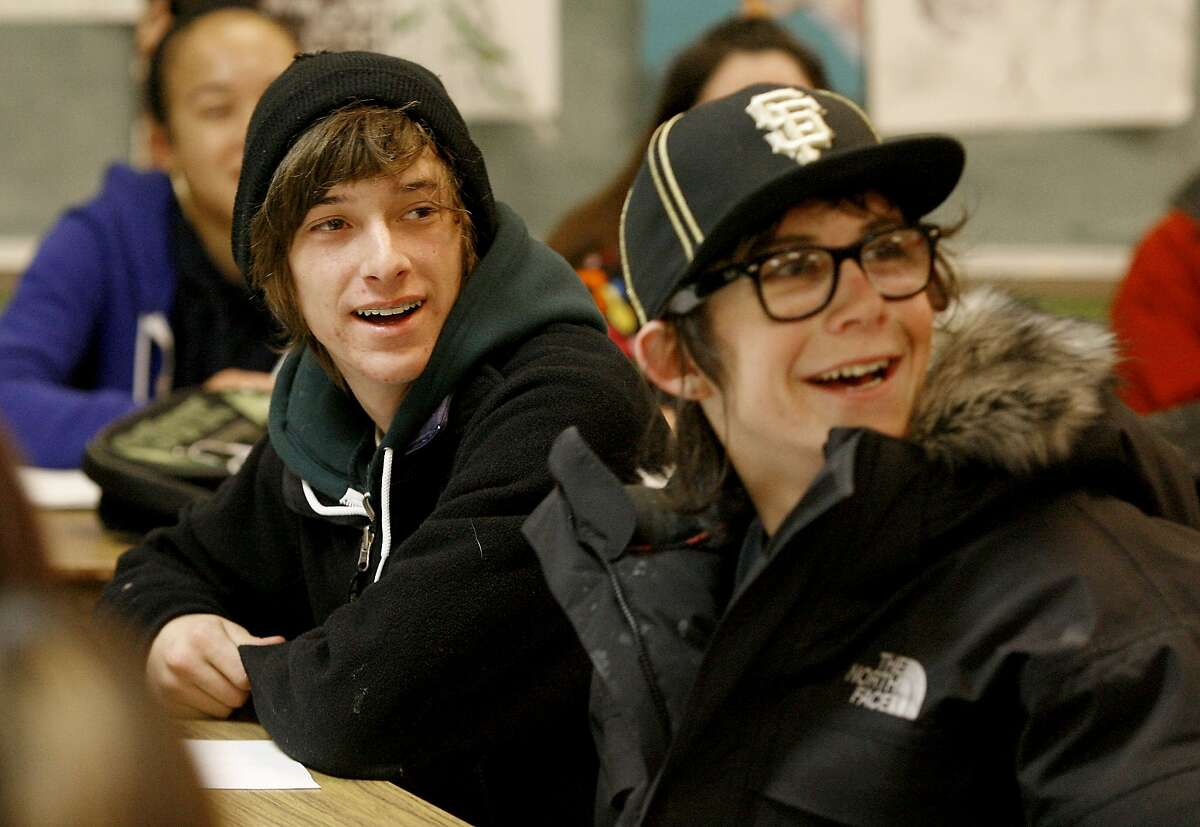 Students George Lachma, left and George Crampton listen to a discussion of sexual diseases during class. At San Francisco's School of the Arts, teacher Keith Carames teaches an animated sexual education class to high school students. {Brant Ward/San Francisco Chronicle}1/18/07