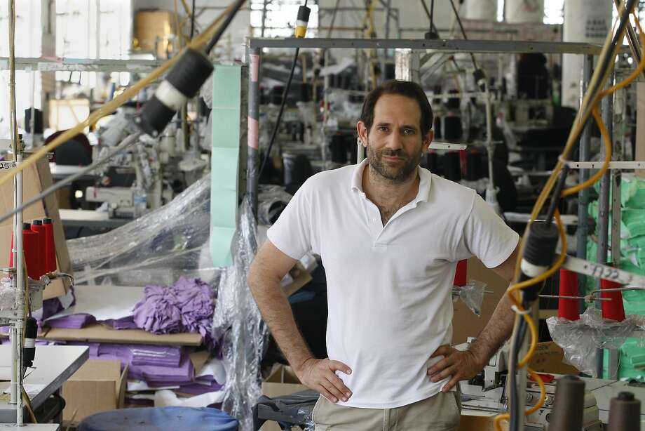In this April 3, 2012 file photo, Dov Charney, founder of American Apparel, poses for photos at the company's factory in downtown Los Angeles. American Apparel on Monday, Oct. 5, 2015 said it has filed for Chapter 11 bankruptcy protection almost a year after ousting founder Charney, who is now locked in a contentious a legal fight with the retailer. (Gary Friedman/Los Angeles Times via AP) Photo: Gary Friedman, Associated Press