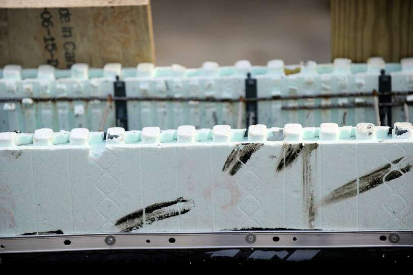Polystyrene foam blocks are filled with concrete to form for Styrofoam building blocks concrete