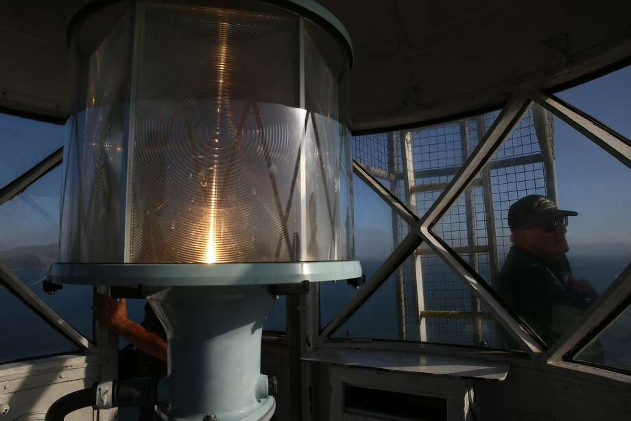 The U.S. Lighthouse Society gives a tour of the Alcatraz lighthouse needing renovation on Alcatraz in San Francisco, Calif., on Monday, October 5, 2015. At far right is rear admiral William Merlin, treasurer of the U.S. Lighthouse Society. Photo: Liz Hafalia, The Chronicle