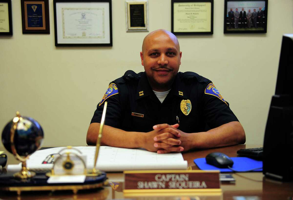 Shelton Police Department's Captain Shawn Sequeira at police headquarters in Shelton, Conn., on Wednesday Apr. 29, 2015. Sequeira is a retired Connecticut State Police officer and has come out of retirement to become the first black supervisor in Shelton police department history.