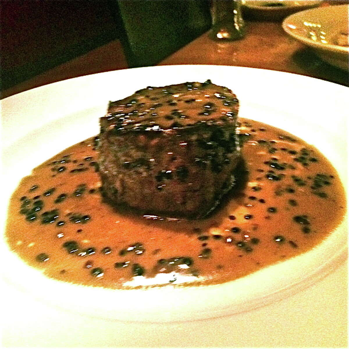 Fileto au povre with a cognac/peppercorn sauce at Mezzanotte. What Alison Cook says:This pepper-steak variant stood tall and proud in its glossy pool of cognac sauce, its texture lush velvet, its buttery sauce deep, its peppercorns packing a wake-up punch. Cuisine: Italian Entree price: $$-$$$$ Where: 13215 Grant, Cypress Phone: 832-717-7870 Website: mezzanotte.tv Read Alison Cook's review of Mezzanotte
