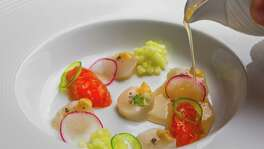 Bay scallop, brown butter, tomato hearts, apple dashi at Cureight, the new tasting-menu facet of Hubbell & Hudson Bistro.