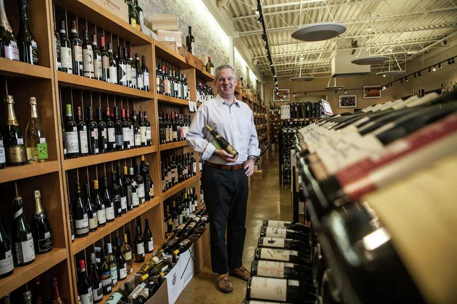 Antonio Gianola, the manager of retail sales at Houston Wine Merchant, poses for a portrait with one of his favorite wines Wednesday September 30, 2015. The wine he's holding is a Trimbach Riesling Frederic Emile 2007. (Michael Starghill, Jr.) Photo: Michael Starghill, Jr., Photographer / © 2015 Michael Starghill, Jr.