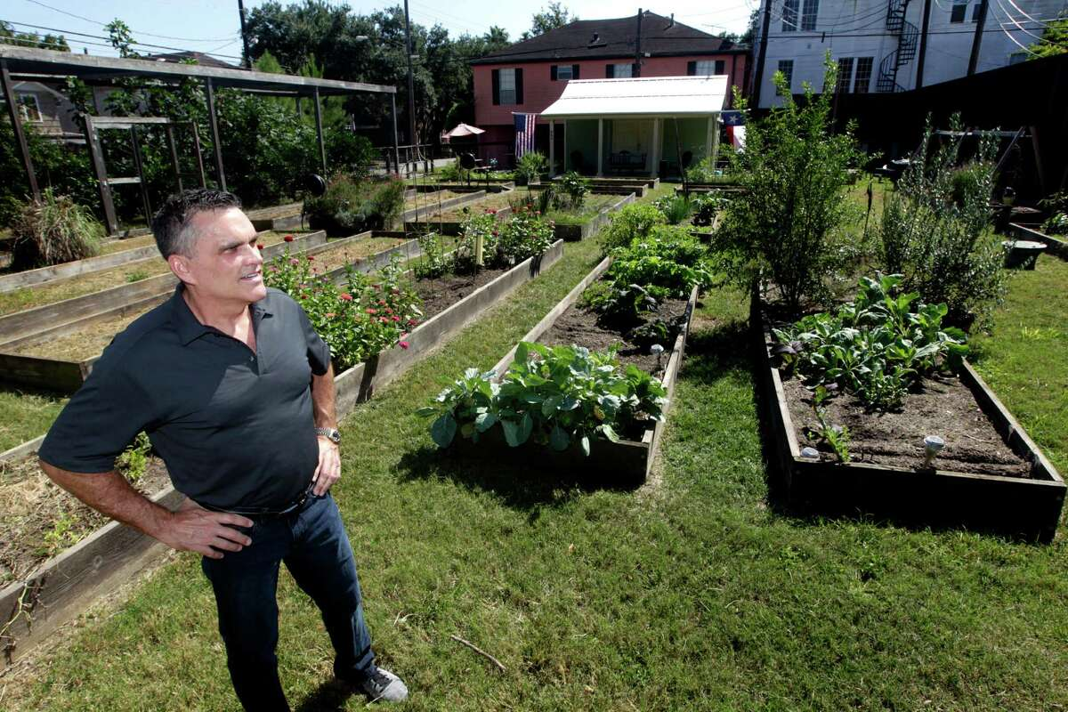Real estate agent Blake Hillegeist stands in the community garden in Montrose that the city has been attempting to buy on Monday, Oct. 5, 2015, in Houston. ( J. Patric Schneider / For the Chronicle )
