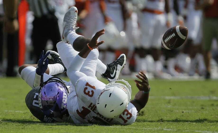 Texas quarterback Jerrod Heard (14) loses the ball after being sacked by TCU linebacker Montrel Wilson (20) during the first half at Amon G. Carter Stadium in Fort Worth, Texas, on Saturday, Oct. 3, 2015. TCU won, 50-7. Photo: Brandon Wade /Fort Worth Star-Telegram / Fort Worth Star-Telegram