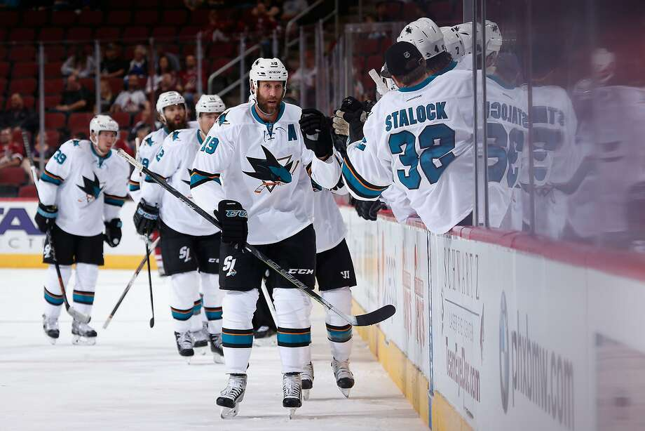GLENDALE, AZ - OCTOBER 02:  Joe Thornton #19 of the San Jose Sharks high fives teammates on the bench after Joe Pavelski (not pictured) scored a first period goal against the Arizona Coyotes during the NHL preseason game at Gila River Arena on October 2, 2015 in Glendale, Arizona.  (Photo by Christian Petersen/Getty Images) Photo: Christian Petersen, Getty Images