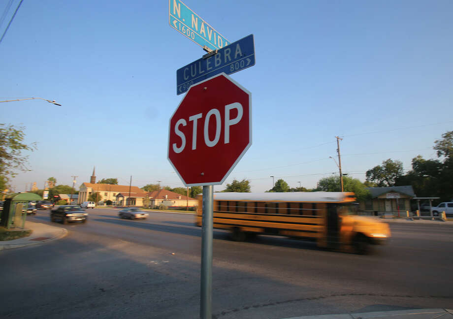 """A school bus passes Thursday the intersection of Culebra and Navidad near where the Texas Department of Transportation plans to build a """"Z-crossing,"""" or a crosswalk with an island in the center where walkers can wait. The city also to build several these crosswalks on Culebra and other busy roads. Photo: John Davenport /San Antonio Express-News / ©San Antonio Express-News/John Davenport"""