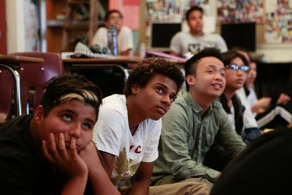 From left, Alejandro Atilano Cornejo, Chris Saniere and Austin Wong from Ali Mayer's 9-12 grade Health Education class at Abraham Lincoln High School watch a video about Hands Only CPR on Monday, Oct. 5, 2015 in San Francisco, Calif.