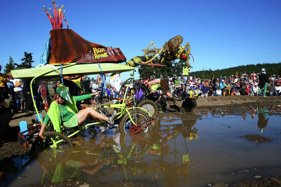 Teams Ptera Ptrike and the Wasp struggle their way through the mud bog during the 33rd annual Great Port Townsend Kinetic Sculpture Race, Sunday, October 4, 2015. Contestants navigated roads, water, sand and other obstacles through Port Townsend in their own human powered sculptures during the two day race. Photo: GENNA MARTIN, SEATTLEPI.COM / SEATTLEPI.COM