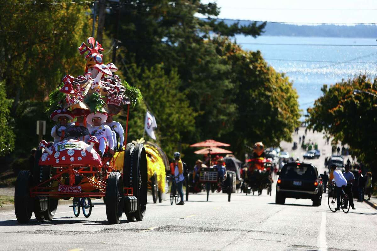 The Fungis team works their way up Monroe Street during the 33rd annual Great Port Townsend Kinetic Sculpture Race, Sunday, October 4, 2015. Contestants navigated roads, water, sand and other obstacles through Port Townsend in their own human powered sculptures during the two day race.