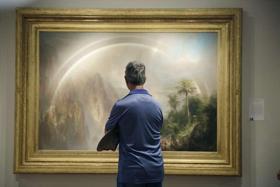 "Joe Bellamah of Richmond, Va., looks at ""Rainy Season in the Tropics"" by Frederic Edwin Church at the de Young Museum  on Sept. 15. Photo: Lea Suzuki, The Chronicle"