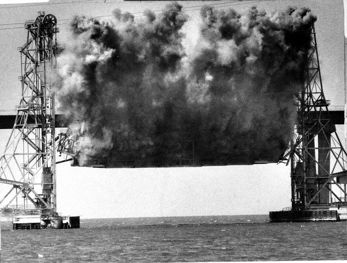 Using explosives to demolish the Drawbridge portion of the Dumbarton Bridge in the South Bay 2 of a 3 photo series .. Photo ran 09/24/1984, p. 2