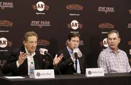 San Francisco Giants president and CEO Larry Baer, left, speaks next to vice president and general manager Bobby Evans, center, and manager Bruce Bochy at a news conference in San Francisco, Monday, Oct. 5, 2015. (AP Photo/Jeff Chiu)