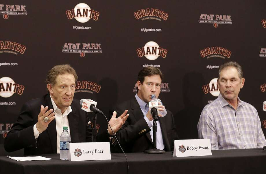 San Francisco Giants president and CEO Larry Baer, left, speaks next to vice president and general manager Bobby Evans, center, and manager Bruce Bochy at a news conference in San Francisco, Monday, Oct. 5, 2015. Photo: Jeff Chiu, Associated Press