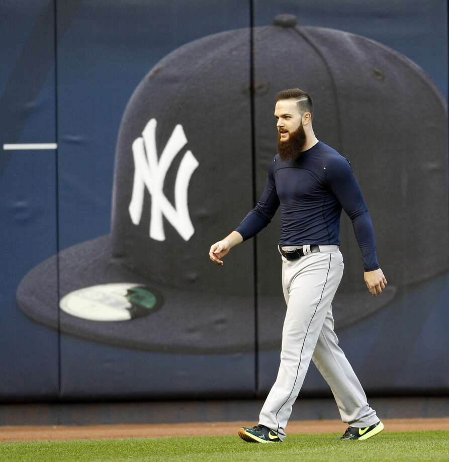 Houston Astros starting pitcher Dallas Keuchel walks past a giant Yankees cap during batting practice at Yankee Stadium on Monday, Oct. 5, 2015, as they prepare for Tuesday's American League Wild Card game in New York. ( Karen Warren / Houston Chronicle ) Photo: Houston Chronicle