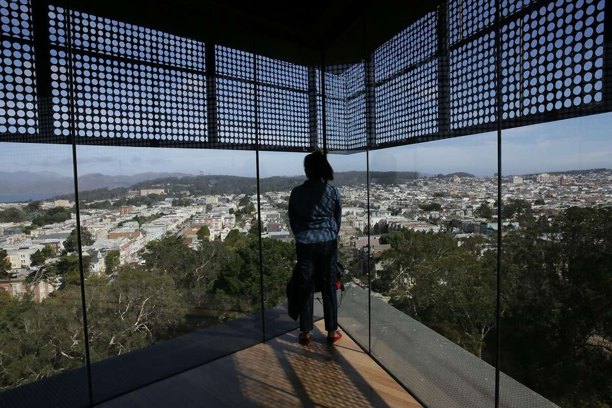 A visitor takes in the view from the top of Hamon Tower at the de Young Museum in September.
