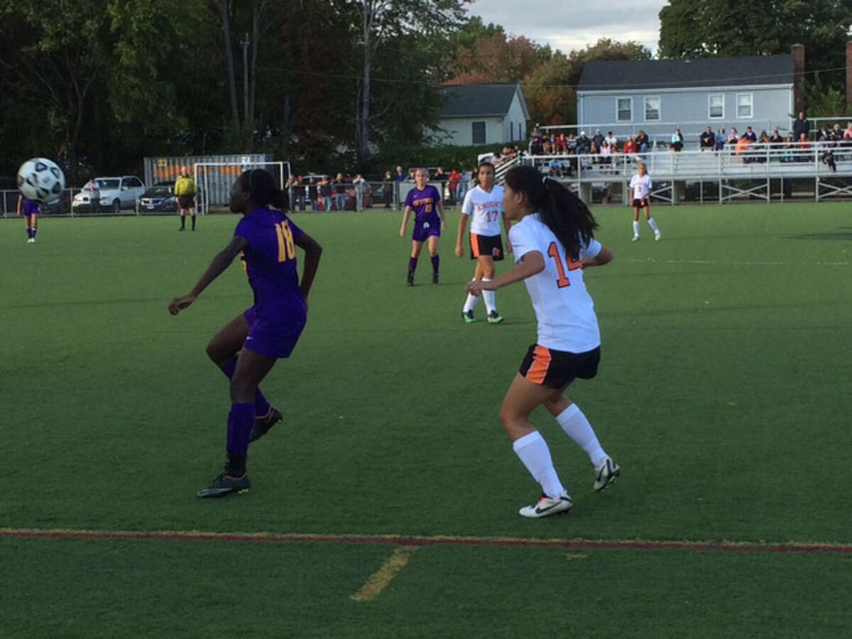 Westhill's Chelsa Domond (18), plays the ball in front of a Stamford defender on Monday. The Vikings won 5-0, clinching the city championship.