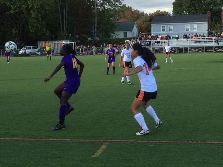 Westhill's Chelsa Domond (18), plays the ball in front of a Stamford defender on Monday. The Vi