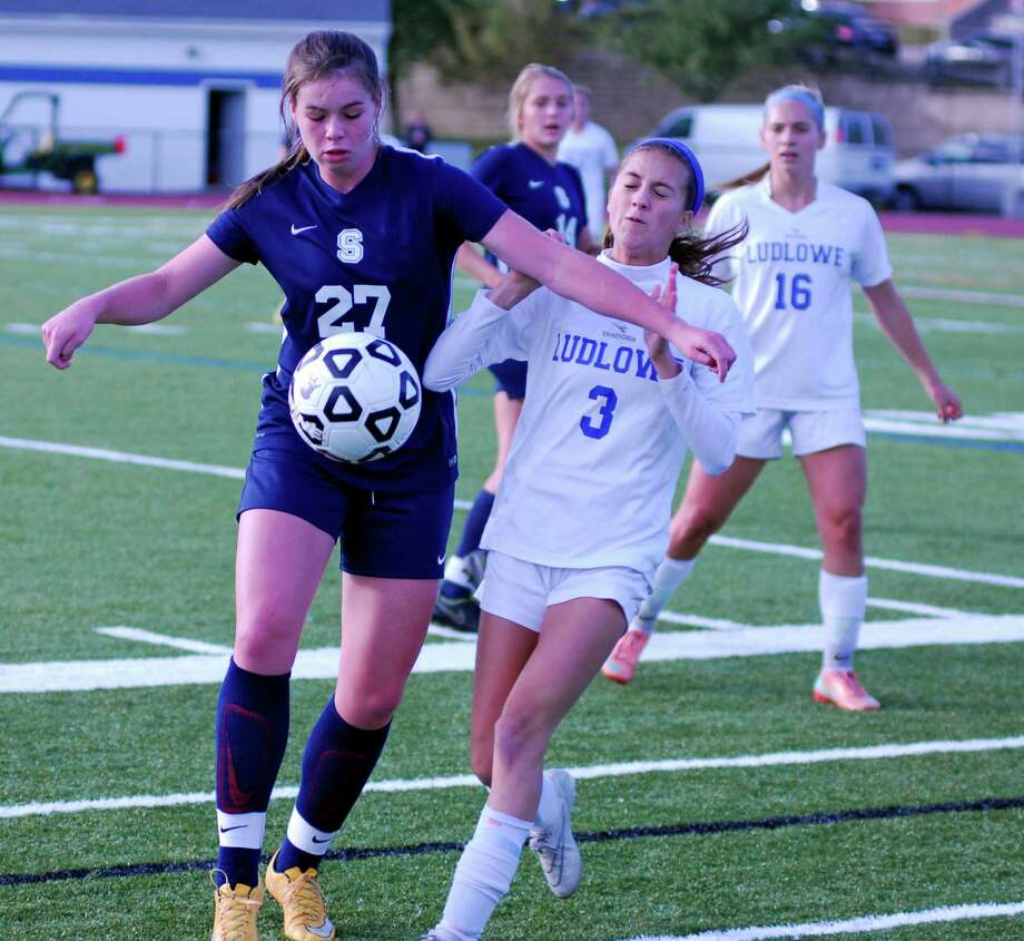 Staples' Charlotte Rossi, left, and Ludlowe's Maddie Roberto battle for possession during a girls soccer game at Ludlowe High School in Fairfield, Connecticut on Monday, Oct. 5, 2015. Ludlowe won 4-2. Photo: Ryan Lacey/Staff Photo / Westport News Contributed