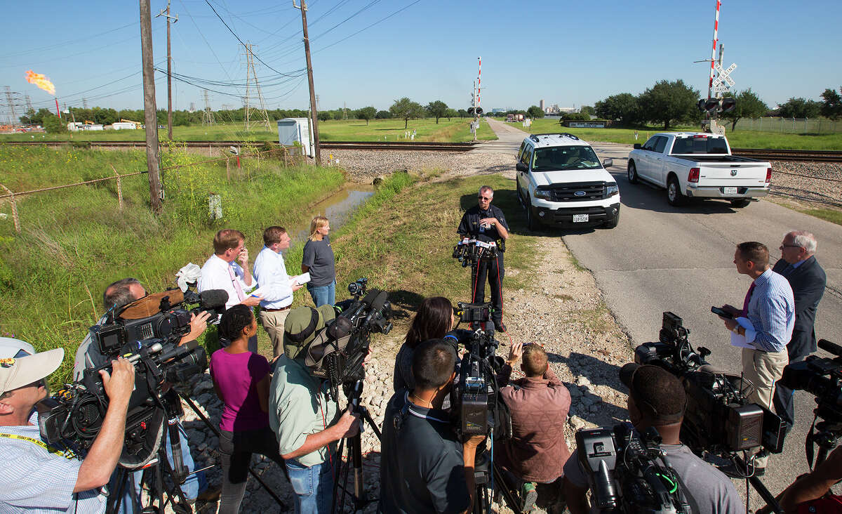 Capt. Dean Hensley of the Harris County Fire Marshal's Office speaks to the media during a news conference after four people were injured in a plant explosion at Sun Edison chemical plant in Pasadena, Friday, Oct. 2, 2015. The workers did not appear to have life-threatening injuries, Hensley said.