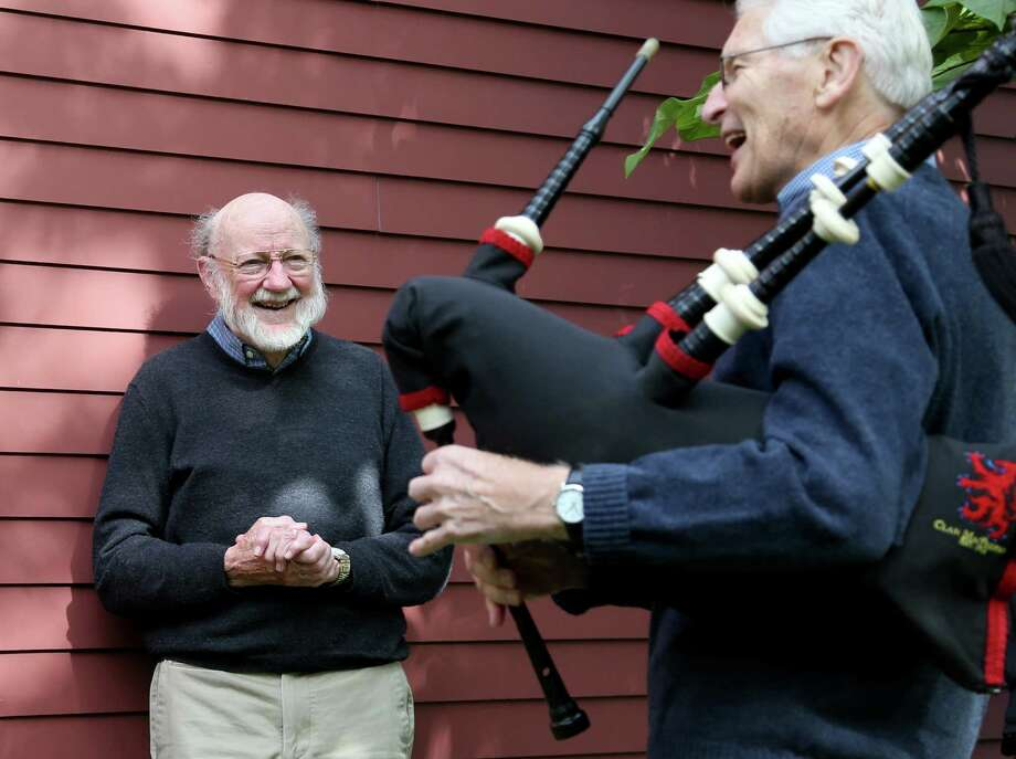 Scientist William C. Campbell, left, is serenaded Monday by neighbor John Truman outside his home in North Andover, Mass., after he was named as one of three recipients of the Nobel Prize in physiology or medicine for developing drugs to fight river blindness and other parasitic diseases.  Photo: Mary Schwalm, FRE / FR158029 AP