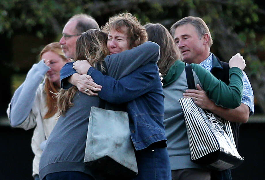 Faculty members embrace as they areturn to Umpqua Community College on Monday in Roseburg, Ore., for the first time since the Oct. 1 shootings that killed nine people on the campus.  Photo: John Locher, STF / AP