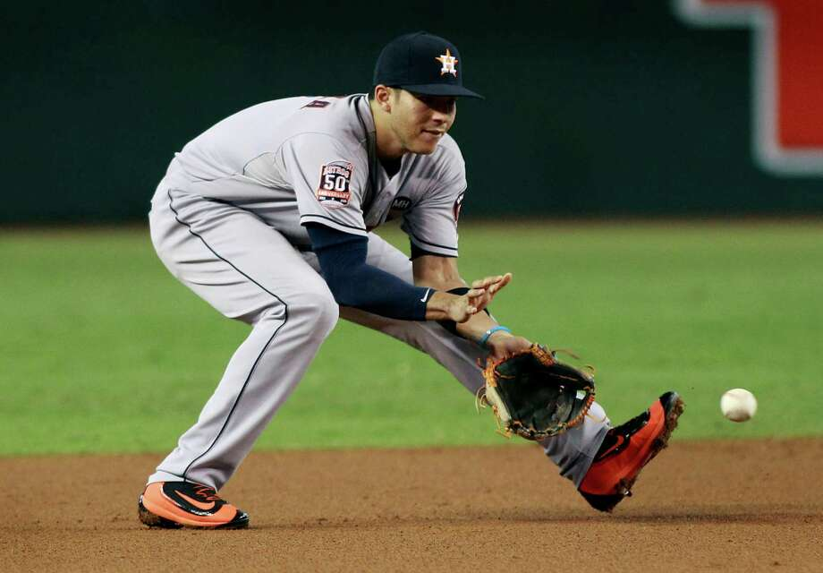 Houston Astros shortstop Carlos Correa fields a ground ball against the Arizona Diamondbacks during the second inning of a baseball game, Sunday, Oct. 4, 2015, in Phoenix. The Diamondbacks defeated the Astros 5-3. Photo: Ralph Freso /Associated Press / FR170363 AP