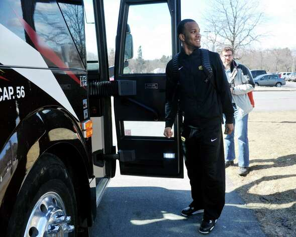 University at Albany basketball player Ray Sanders walks onto a bus at the college on Wednesday, March 18, 2015, in Albany, N.Y.  The team was heading to the airport to fly to Columbus for the NCAA Tournament.  (Paul Buckowski / Times Union) Photo: PAUL BUCKOWSKI / 00031071A