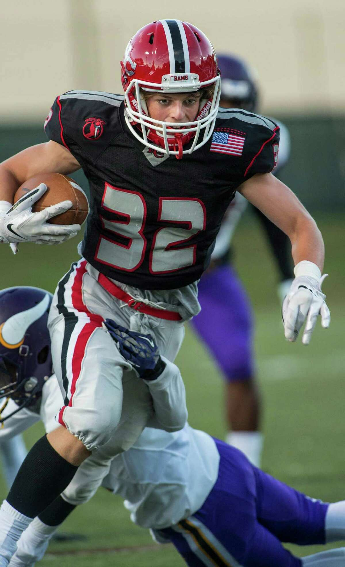 New Canaan High Schools Graham Braden trying to get by a Westhill High School defender during a football game played at New Canaan High School, New Canaan, CT on Monday, October 5, 2015.