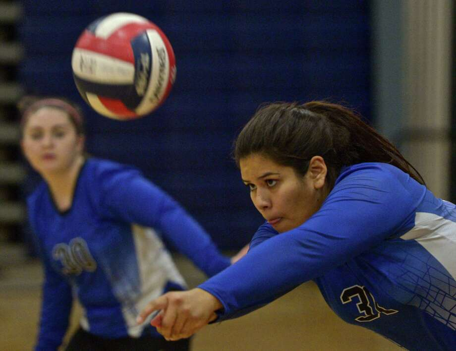 FILE PHOTO: Abbott Tech's Raquel Diaz (31) digs out a serve in the girls high school volleyball match between Henry Abbott Technical and Immaculate high school on Wednesday afternoon, September 23, 2015, at Immaculate High School, in Danbury, Conn. Photo: H John Voorhees III / Hearst Connecticut Media / The News-Times