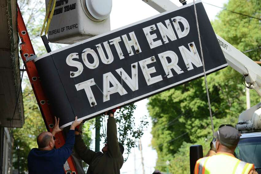 The iconic South End Tavern sign is removed by workers from the City of Troy Monday afternoon, Oct. 5, 2015, on Burden Ave in Troy, N.Y. The Rensselaer County Historical Society raised money to purchase both of the building's signs. (Will Waldron/Times Union)