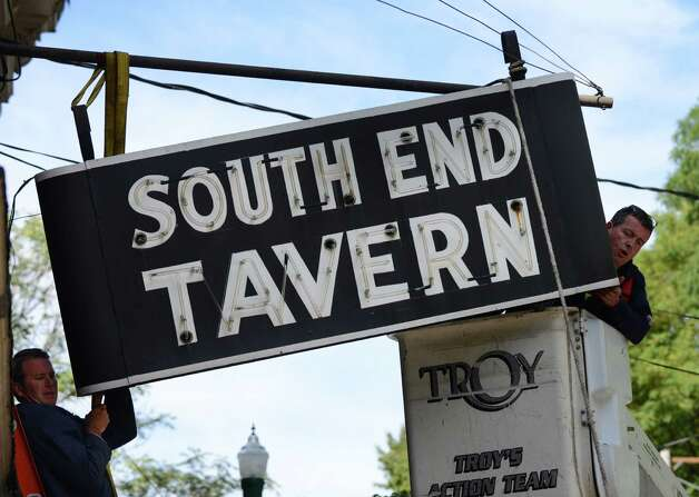 The iconic South End Tavern sign is removed by workers from the City of Troy Monday afternoon, Oct. 5, 2015, on Burden Ave in Troy, N.Y. The Rensselaer County Historical Society raised money to purchase both of  the building's signs. (Will Waldron/Times Union) Photo: Will Waldron / 10033629A