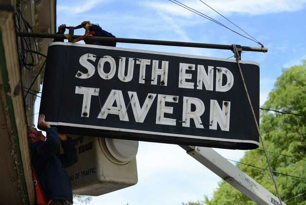 The iconic South End Tavern sign is removed by worker from the City of Troy Monday afternoon, Oct. 5, 2015, on Burden Ave in Troy, N.Y. The Rensselaer County Historical Society raised money to purchase both of the building's signs. (Will Waldron/Times Union) Photo: Will Waldron / 10033629A