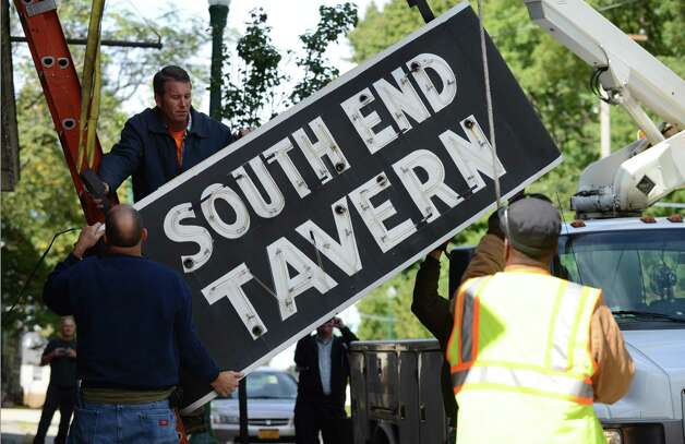 The iconic South End Tavern sign is removed by workers from the City of Troy Monday afternoon, Oct. 5, 2015,on Burden Ave in Troy, N.Y. The Rensselaer County Historical Society raised money to purchase both of the building's signs. (Will Waldron/Times Union) Photo: Will Waldron / 10033629A