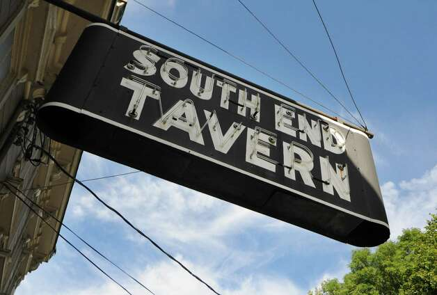 The iconic South End Tavern sign hangs in front of the building before being removed Monday afternoon, Oct. 5, 2015, on Burden Ave in Troy, N.Y. The Rensselaer County Historical Society raised money to purchase both of the building's signs. (Will Waldron/Times Union) Photo: Will Waldron / 10033629A