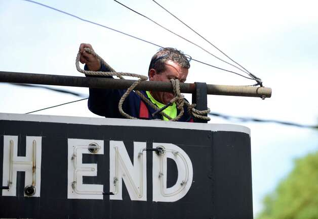 The iconic South End Tavern sign is removed by a worker from the City of Troy Monday afternoon, Oct. 5, 2015, on Burden Ave in Troy, N.Y. The Rensselaer County Historical Society raised money to purchase both of the building's signs. (Will Waldron/Times Union) Photo: Will Waldron / 10033629A