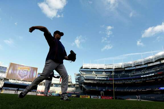 The Astros' Jed Lowrie, warming up Monday at Yankee Stadium, experienced high drama in last year's AL wild-card tilt when his A's fell to the Royals in 12 innings.