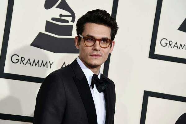 FILE - In this Feb. 8, 2015, file photo, John Mayer arrives at the 57th annual Grammy Awards at the Staples Center in Los Angeles. Members of the Grateful Dead and Mayer are giving 10,000 free tickets to their concert next month. (Photo by Jordan Strauss/Invision/AP, File) ORG XMIT: NY110