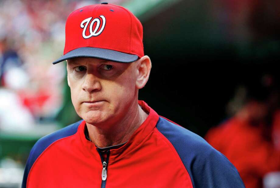 In this June 21, 2014, file photo, Washington Nationals manager Matt Williams walks in the dugout before the Nationals' baseball game against the Atlanta Braves in Washington. Williams has been chosen NL Manager of the Year after guiding the Nationals to the league's best record in his first season on the job. Williams got 18 first-place votes and 109 points in balloting by the Baseball Writers' Association of America announced Tuesday, Nov. 11. (AP Photo/Alex Brandon, File) Photo: Alex Brandon, STF / AP
