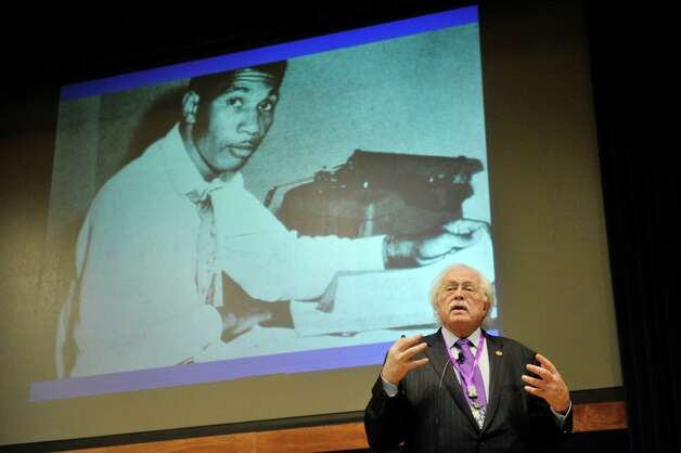 A photograph of Medgar Evers is seen on the screen as Dr. Michael Baden, a board-certified forensic pathologist, gives a talk about the work he did on the Medgar Evers case at the New York State Police Academy during a seminar on forensic sciences and technology in solving criminal cases on Monday, Oct. 5, 2015, in Albany, N.Y.  Representatives from departments from 29 states across the US, as well as countries such as Canada, Estonia, Germany, Latvia, Lithuania and Russia are taking part in the seminar.  (Paul Buckowski / Times Union) Photo: PAUL BUCKOWSKI / 10033625A