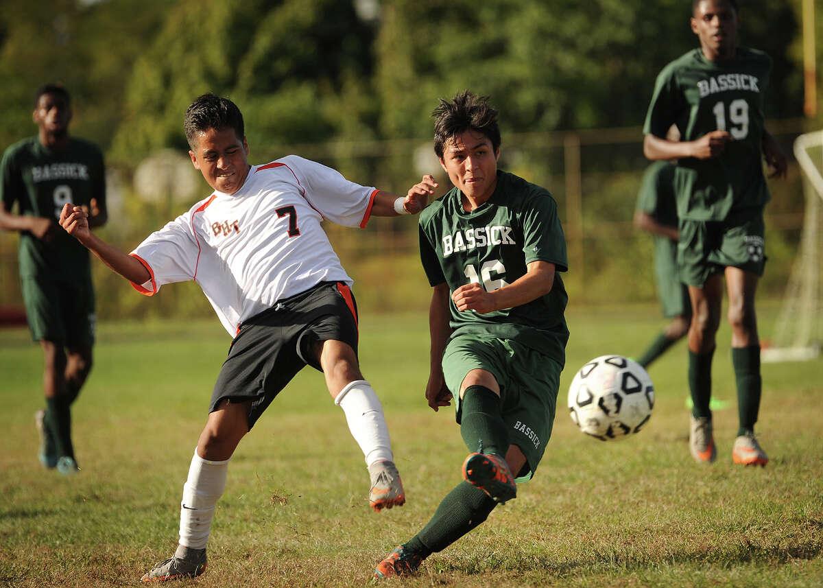 Bullard Havens' Brayan Marin, left, is beaten to the ball by Bassick's Tammon Montanaro in the first half of their boys soccer match at Bullard Havens High School in Bridgeport, Conn. on Monday, October 5, 2015.